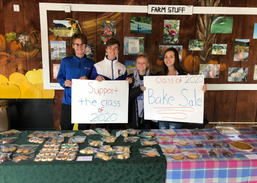 Senior Kerry Daley and fellow senior class officers Dylan Hotter, Abbie Ellis, and Rachel Court host a bake sale at Mack's Apples. Cookies and fall treats were sold in the beginning of September to raise money for the senior class.
