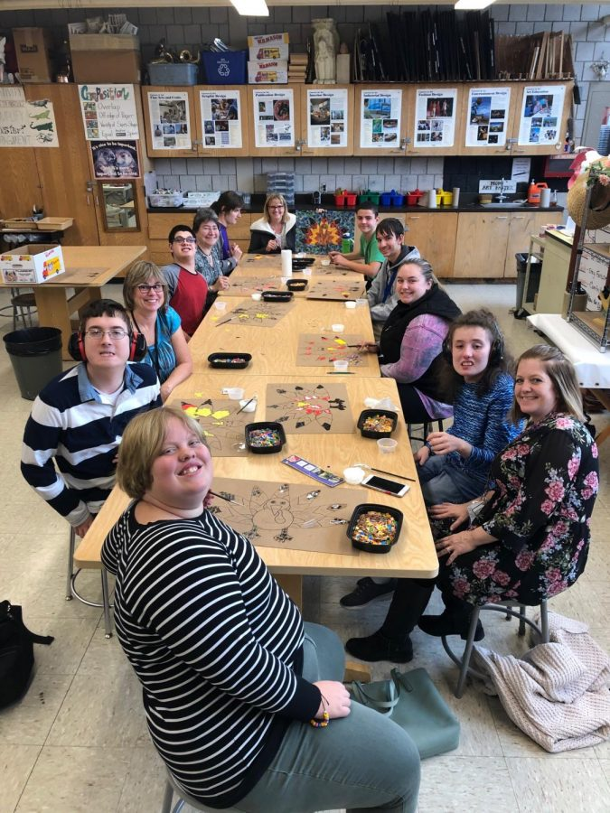 The+art+interactive+class+takes+a+quick+break+from+working+on+their+mosaic+turkey+art+projects.+Members+of+this+class+work+with+%22helpers%22+as+they+learn+how+to+create+a+variety+of+pieces+of+art.