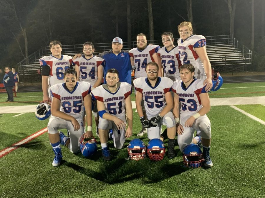 Captain+Cooper+Bartlett+and+the+Lancer+linemen+pose+for+a+picture+after+their+game.+The+Lancers+beat+the+Pinkerton+Astros+by+a+score+of+42-24.