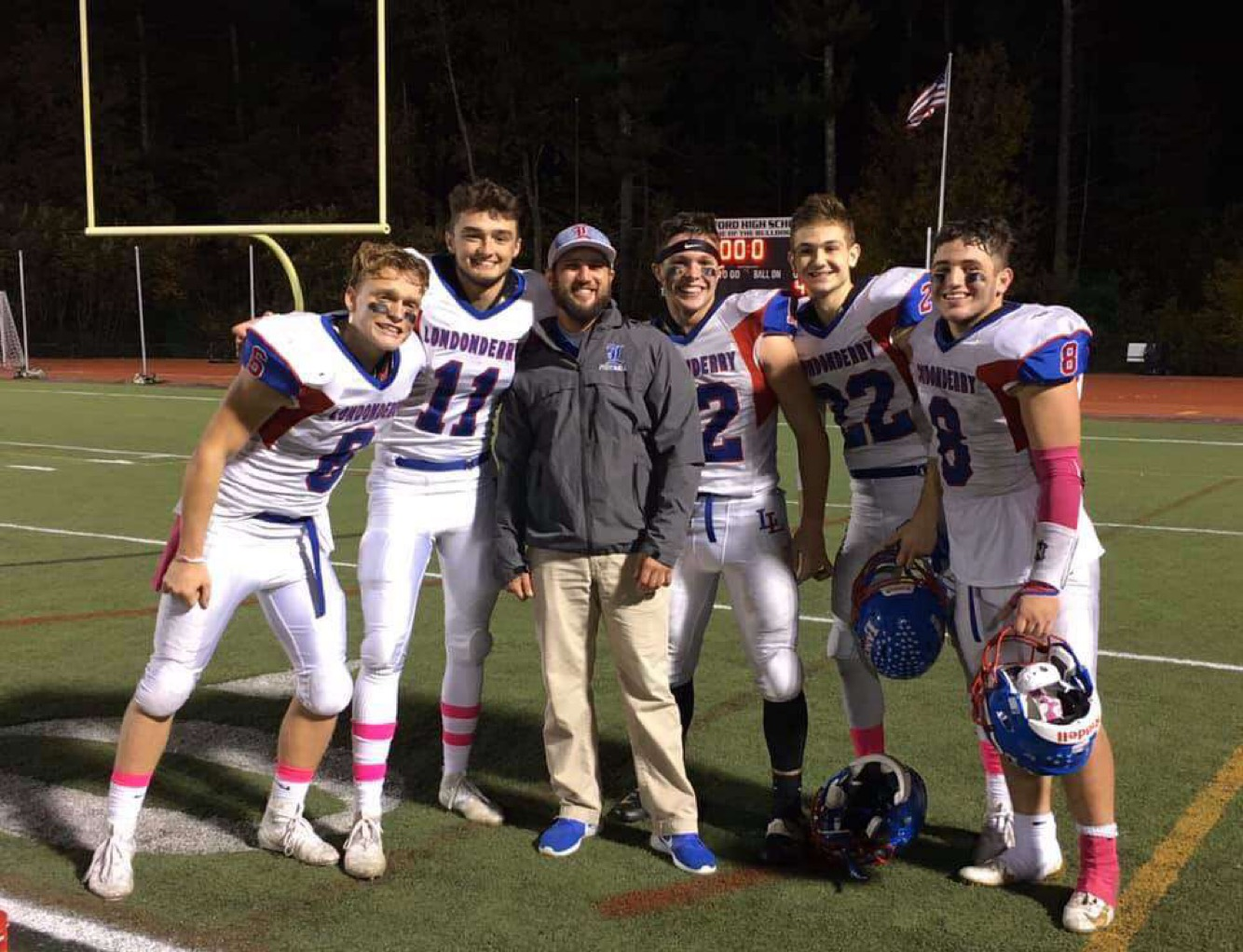 Lancer defenders pose with defensive coordinator, Coach Clement. The Lancers completed an undefeated season with a dominant defense led by Clement.