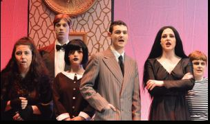 The cast of the Addams Family from the show in April 2019 pose at the beginning of the show during one of their feature songs.