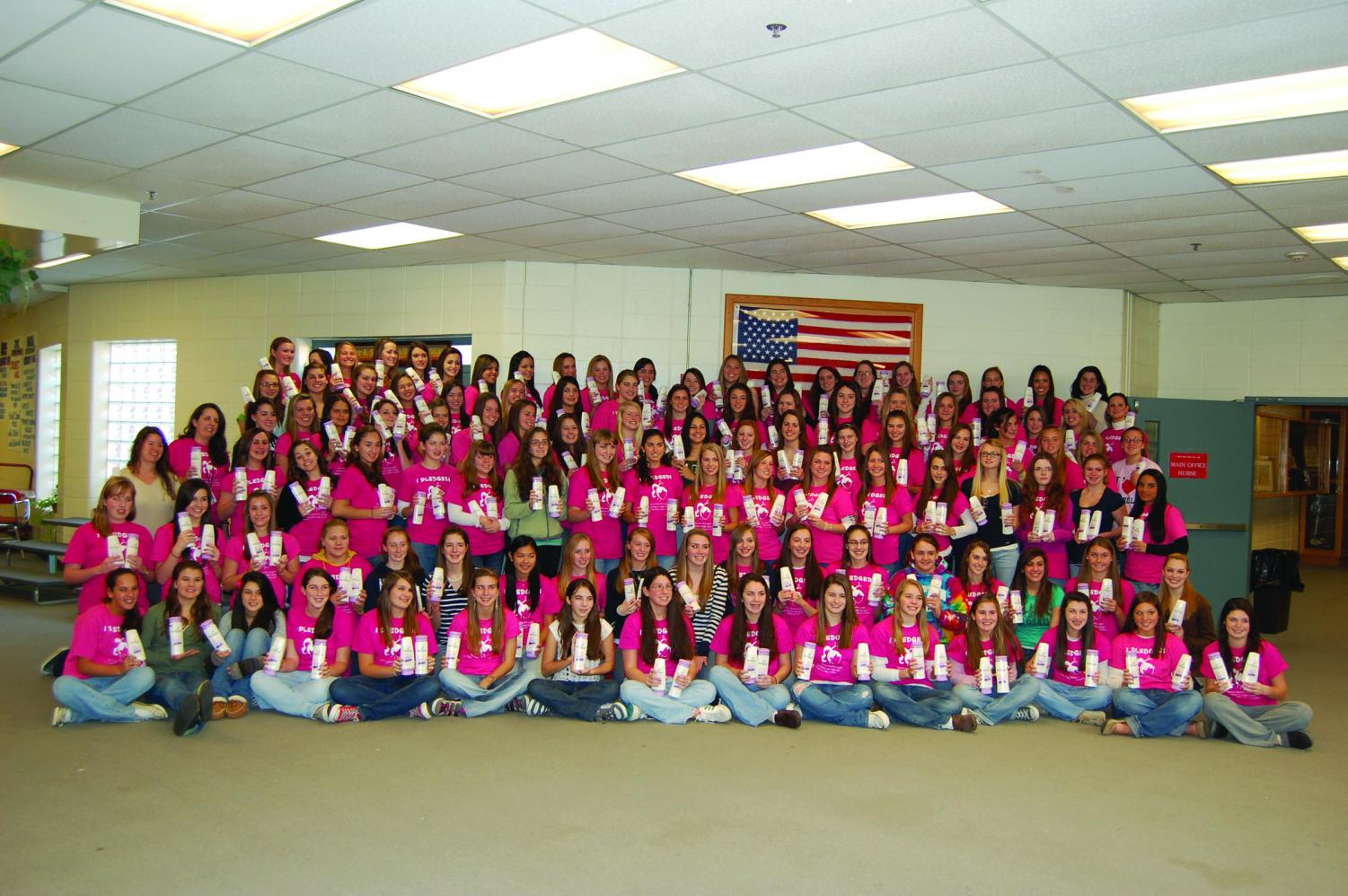 The Angels on the Day of Giving each year anxiously wait for the moment when they will donate their hair in front of the entire school.