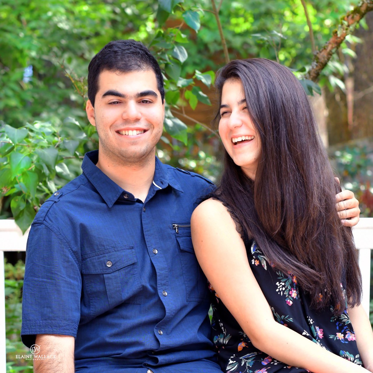 Brandon and Jillian Morani laugh together during their senior photos.