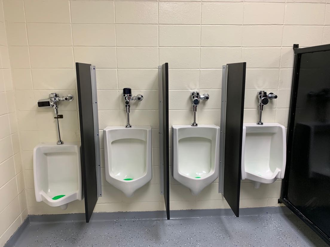 Urinal dividers are currently located in the men's bathroom in the main lobby.