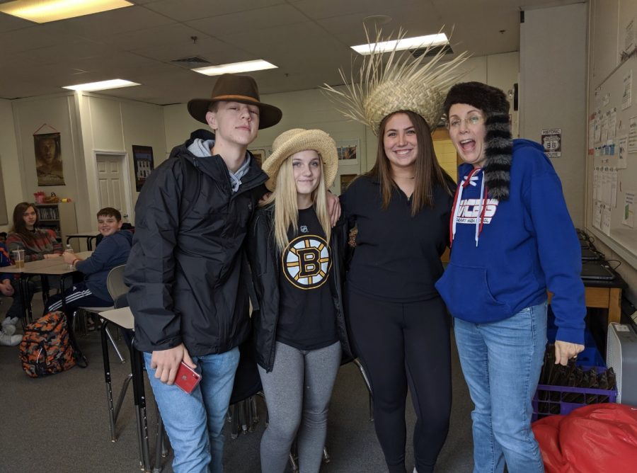 Mrs.Juster poses with a few students on crazy hat day during spirit week.
