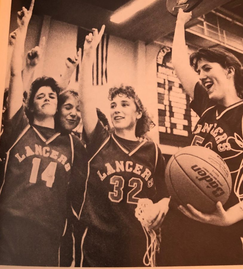 Katie Sullivan celebrates with her fellow teammates on becoming the state champion of 1990 girls basketball.