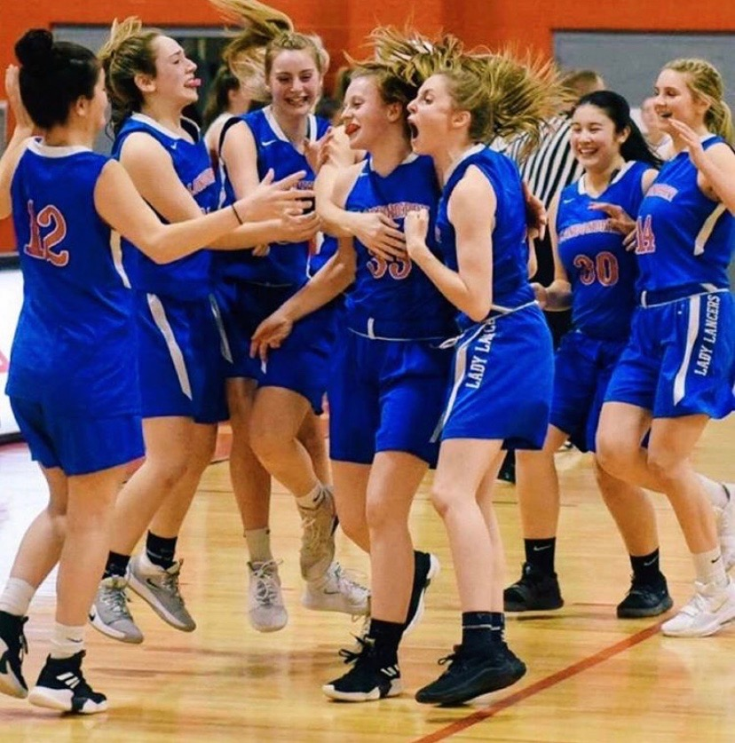 Girls%27+Varsity+Basketball+celebrates+win+after+their+first+playoff+game+against+Pinkerton.+