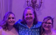 Senior Meghan Onessimo and graduate Emily Lavacchia were both in psychology teacher Ms. Gagnon's class, so they made sure to get a photo with her at the 2019 prom.