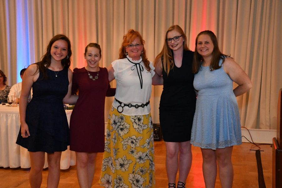 Horne+poses+for+a+picture+with+past+and+present+Colorguard+members+at+banquet.