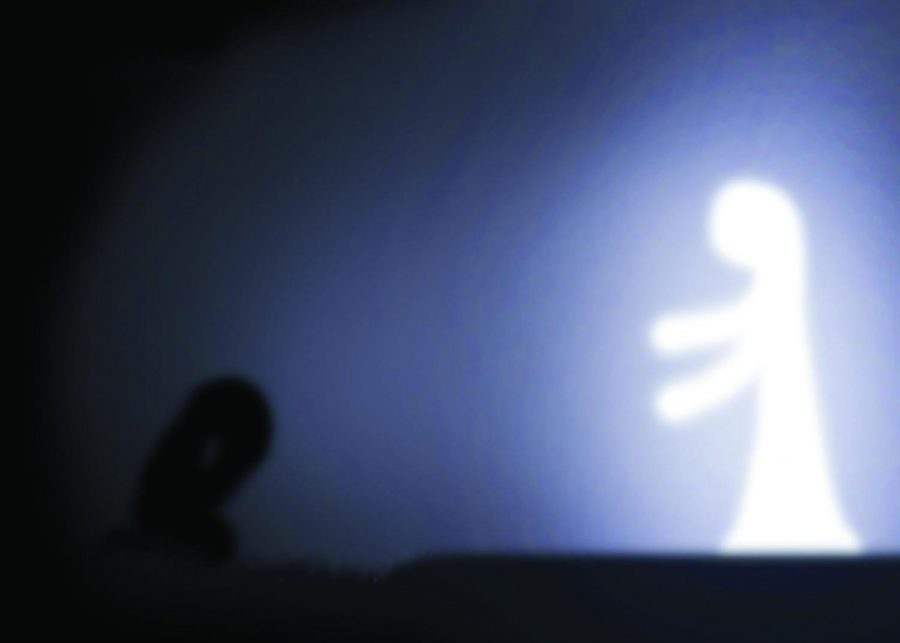 A creative symbolization of God reaches out to a lonely, despaired person in need of His light.