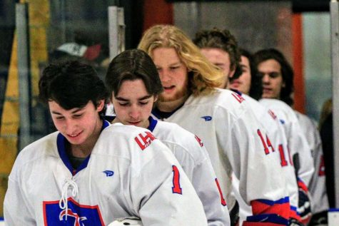 Ziv and the rest of the varsity hockey team head out onto the ice during a game.