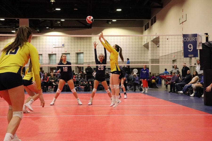Haas sets the ball at her club volleyball tournament in Providence, Rhode Island. Haas looks forward to this tournament every year because of the intense competition.