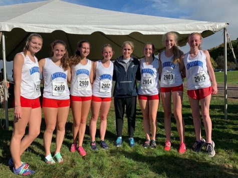 Mrs. Sanborn and her 2019-2020 team gathering for a photo following a cross country meet.