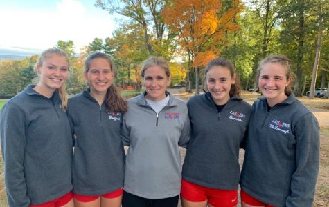 Senior cross country girls with Mrs. Sanborn after their final meet for the fall season.