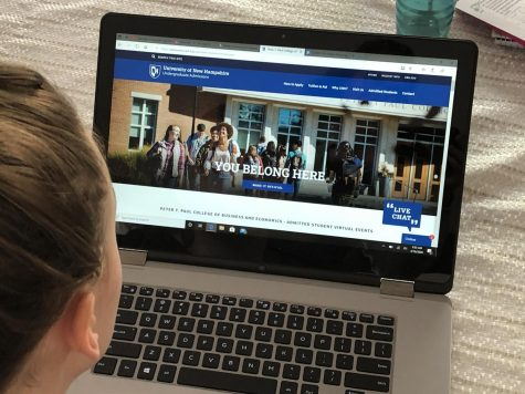 Students look through college website for virtual Admitted Students Day sign-ups.
