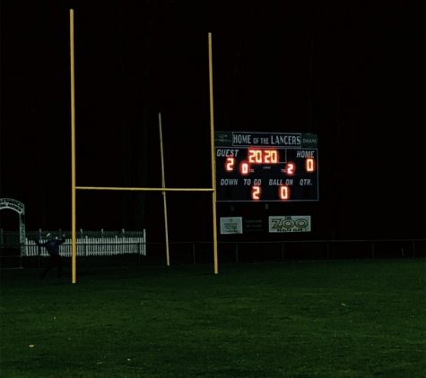 "LHS lit up the football field scoreboard with the numbers ""2020"