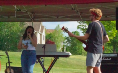 "Carleigh Mack and her bandie, Nathan Pevear, rocking out a cover of ""Bad Guy"" by Billie Eilish."
