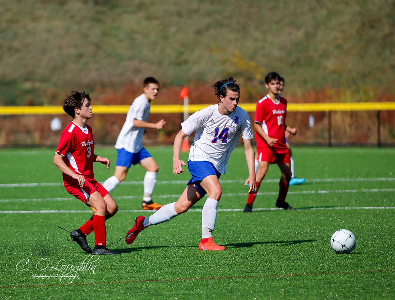 Hunter Smith running towards the ball in game against Pinkerton.