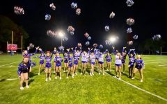 Lancer Varsity cheer celebrates the win after the Mack Plaque football game