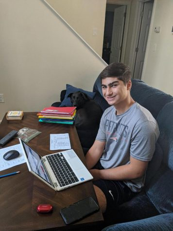 Junior Christopher Merheb works on schoolwork from his living room.