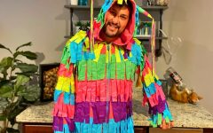 Spanish teacher Rodrigo Rosa-Blackburn shakes his crepe paper during his dance in a piñata costume as the winner of this year's contest put on by the Drama Club.