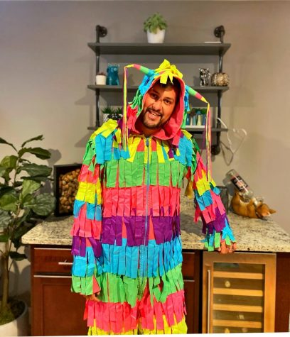 Spanish teacher Rodrigo Rosa-Blackburn shakes his crepe paper during his dance in a piñata costume as the winner of this year