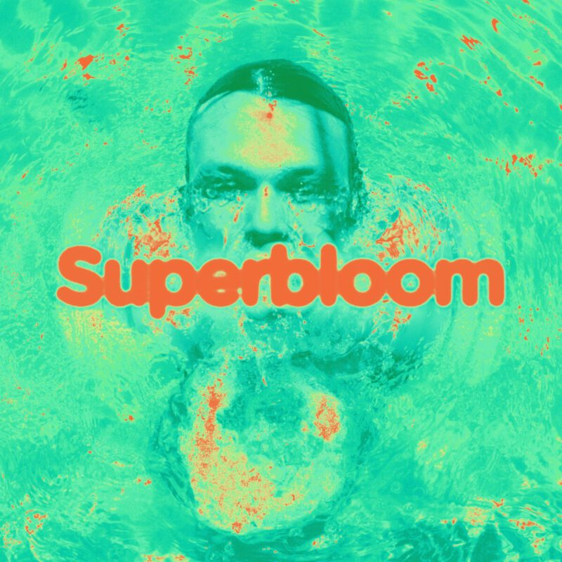 Irwin emerges from a green pool as the cover artwork of 'Superbloom.' The album was released Oct. 23, 2020, and has ten tracks.