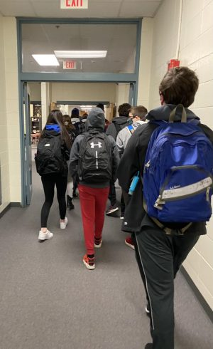 Students walk through the halls during their