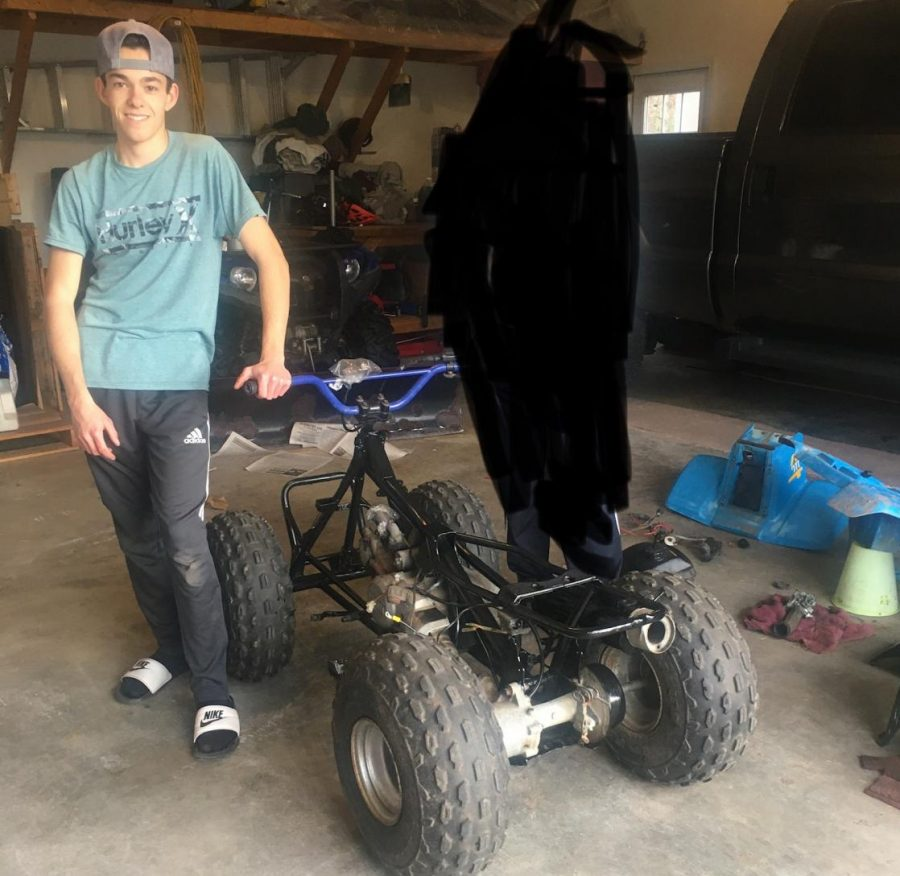 Setterland takes a moment to snap a photo before taking his newly built ATV for a ride.