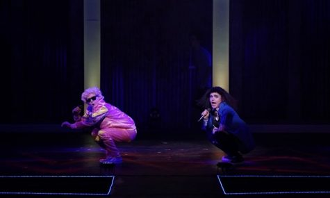 Evie performs alongside another cast member in