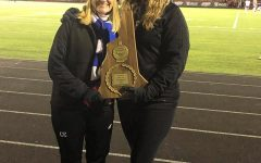 Unified coach Mrs. Tebbetts holds the the Unified soccer championship plaque alongside assistant coach Colleen Ellis.
