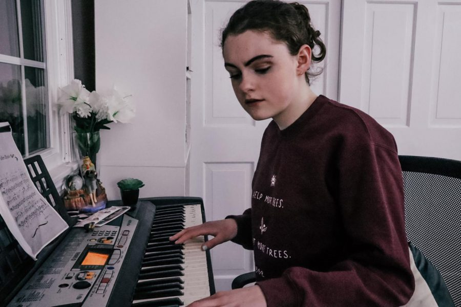 Freshman Michaela Horan sits at the piano, focusing her attention on composing her next piece of music. Having been writing since she young, Horan feels that her music is the best expression of herself.