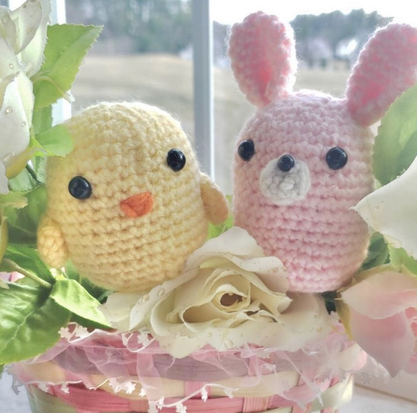 Chen snaps a picture of her Easter-themed bunny and chick crochets to put online on her Etsy shop. These crochets are a few of the many she sells.