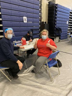 Ms. Sullivan receives her first COVID-19 vaccine. Teachers and staff who got vaccinated this day have to wait two weeks to receive the second dose.