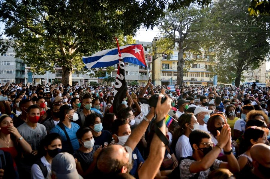Cubans+take+to+the+streets+to+protest+against+their+government+in+hopes+to+attract+international+aid+and+intervention.