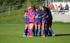 Girls Soccer huddles before game against Hanover.