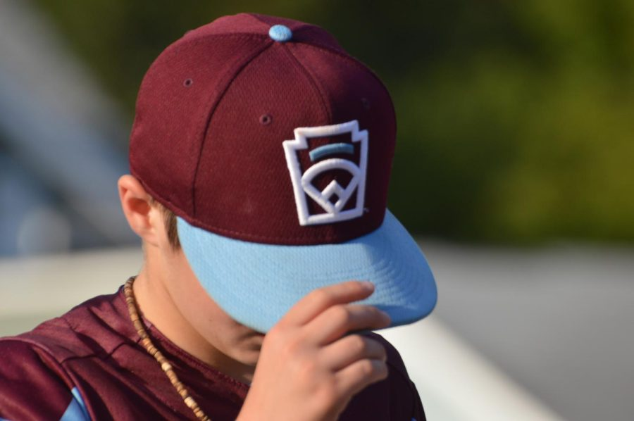 Outfielder Jacoby Acevedo dawns his New England cap during celebration parade. Acevedo had a near perfect fielding average in the LLWS while holding a .000 ERA as a pitcher.