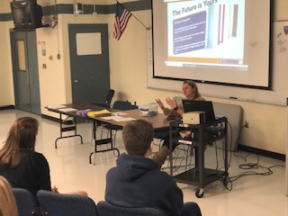 House 4 school counselor Mrs. Chase speaks with groups of students, giving them the information they'll need as they prepare for course selections.