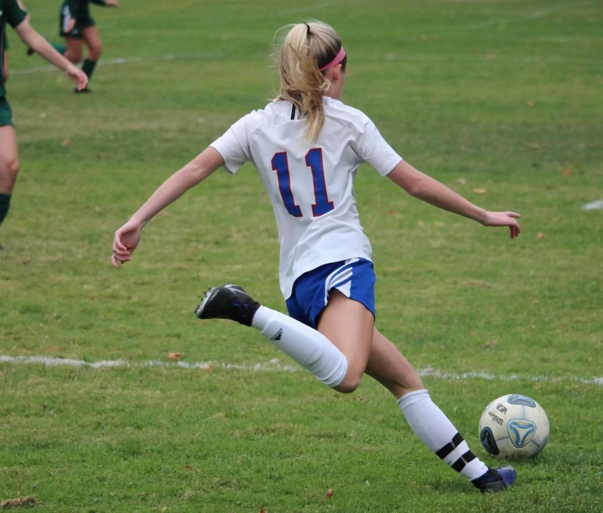 With her fast footwork, senior Olivia Stowell helps her team win the game against Dover, 5-1.